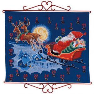 Julekalender julemand i kane blå baggrund