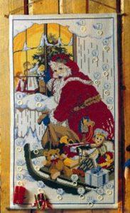Julemanden kigger ind i en stue